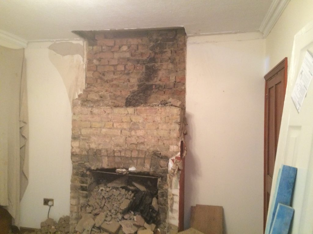 How to remove a chimney -  By Removing The Breast And Making Good The Wall It Would Allow The Owners To Use The Whole Rear Wall For Placing The Much Needed Sofa Along